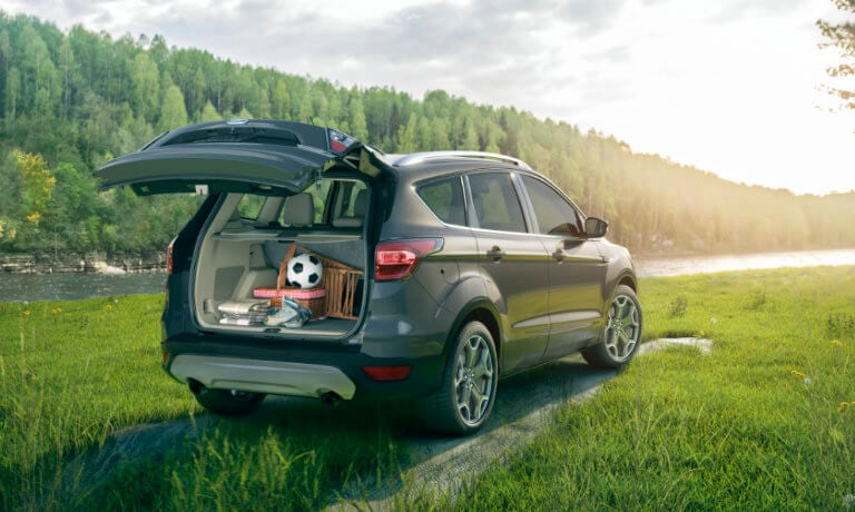 2019 Ford Escape open trunk parked in field