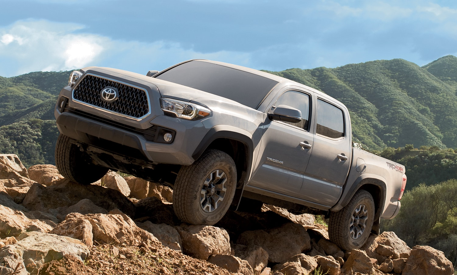 Tacoma off-roading on a rocky hillside