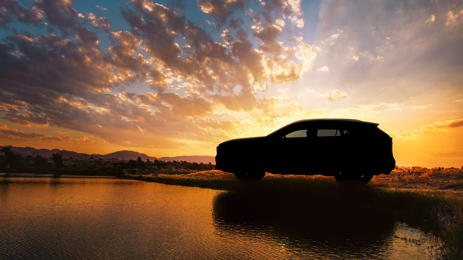 RAV4 silhouette in front of a sunset