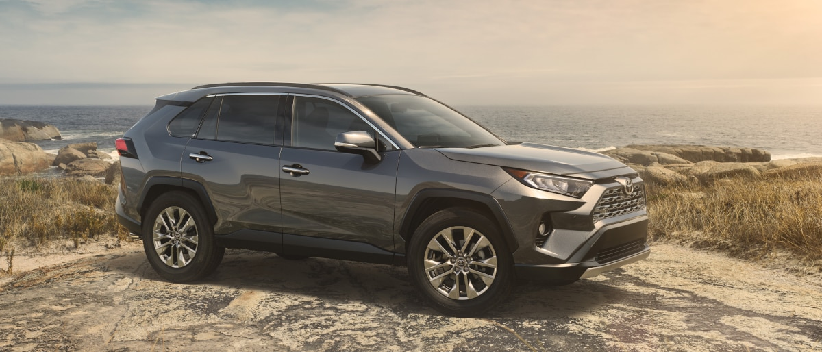 Profile outdoor view of a silver 2019 RAV4