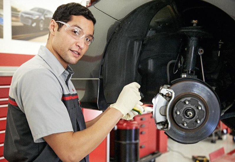 A Toyota Certified Technician working on a Brake Job