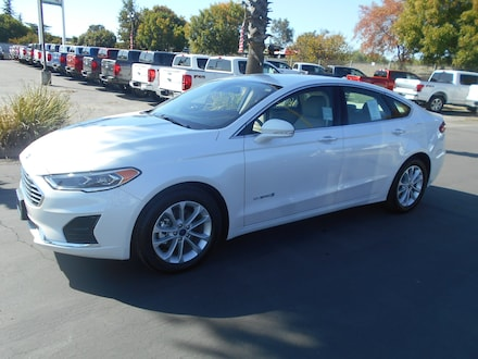 Featured new Ford cars, trucks, and SUVs 2019 Ford Fusion Hybrid SEL Sedan for sale near you in Corning, CA