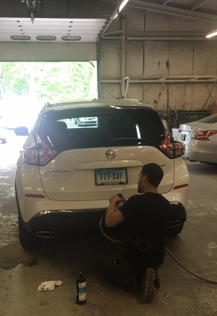 Auto Body Repair Being Done To A Nissan SUV
