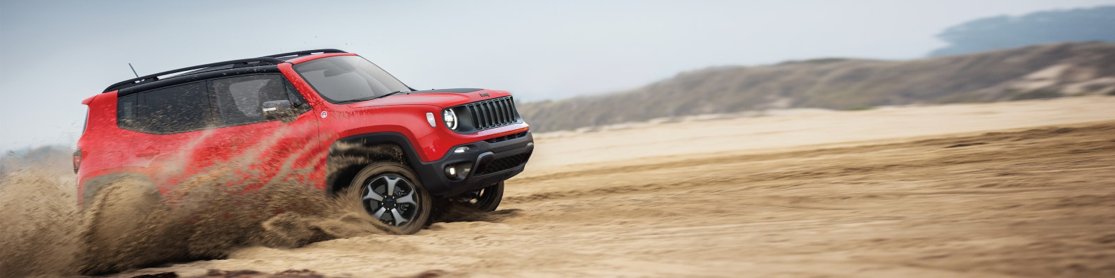 New Jeep Renegade driving through the desert