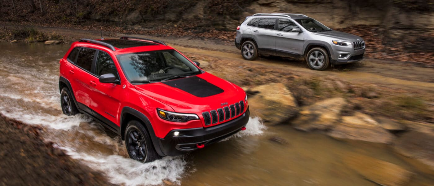 2020 Jeep Cherokee exterior two Cherokee's in woods by stream