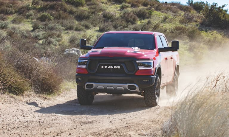 2019 Ram 1500 exterior at beach with surfers