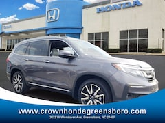 2021 Honda Pilot Touring 8 Passenger FWD SUV DYNAMIC_PREF_LABEL_INVENTORY_LISTING_DEFAULT_AUTO_NEW_INVENTORY_LISTING1_ALTATTRIBUTEAFTER