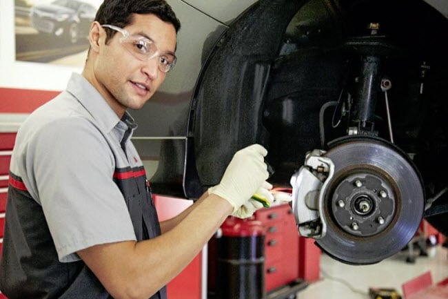 Toyota Service Tech Working on Brakes