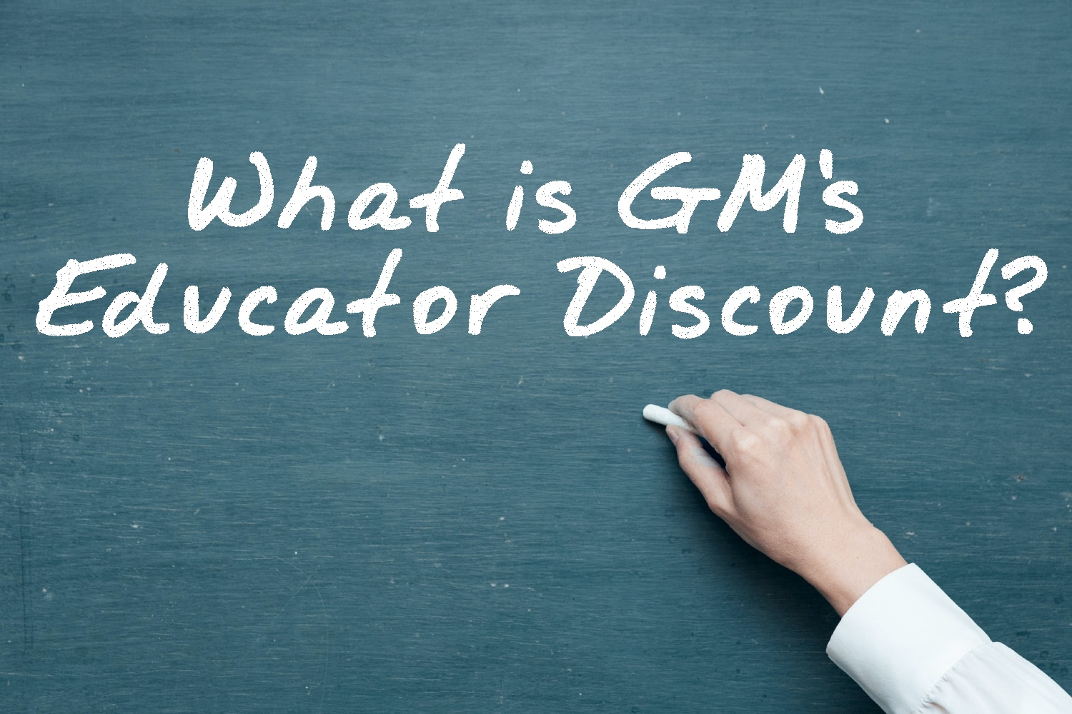 """Writing on Chalkboard """"What is GM's Educator Discount?"""""""