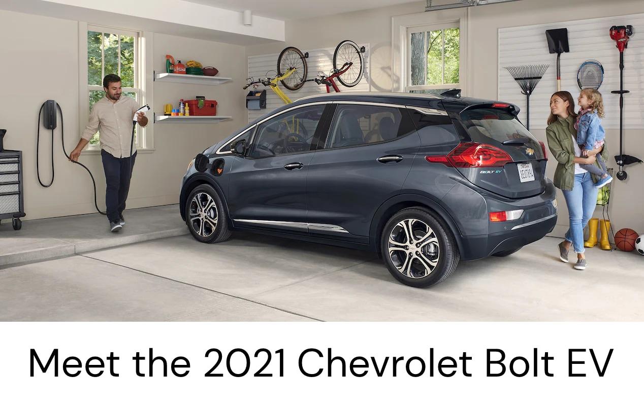 Chevrolet Bolt EV in garage with family