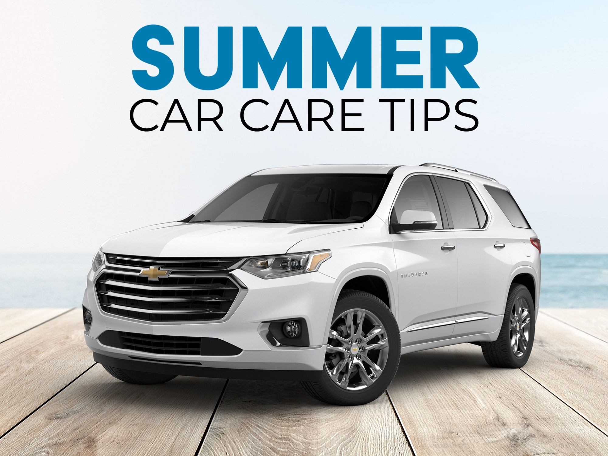 White Chevrolet Traverse parked on boardwalk with sea background