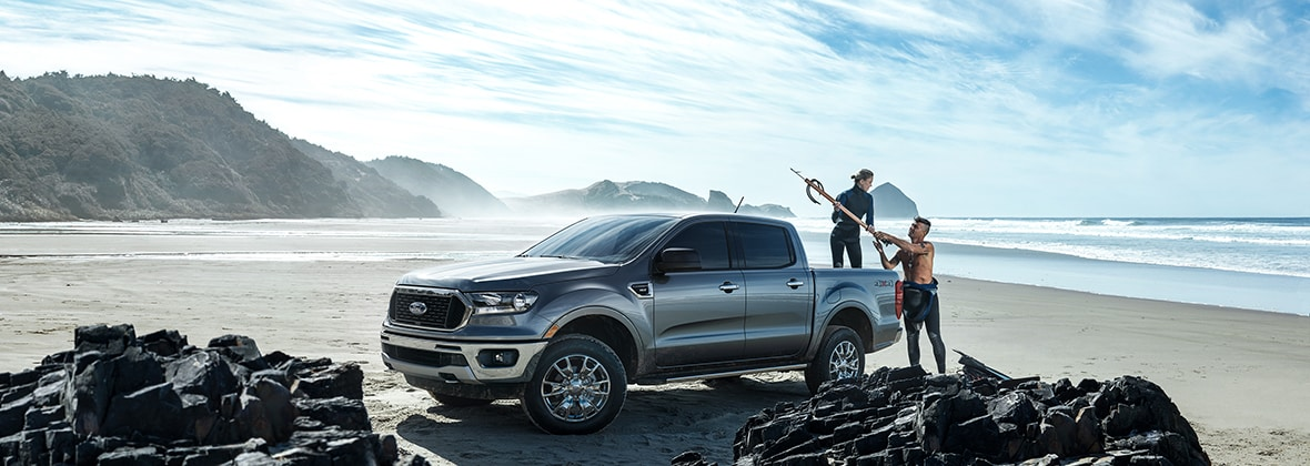 All New Ford Ranger on the beach with surfers