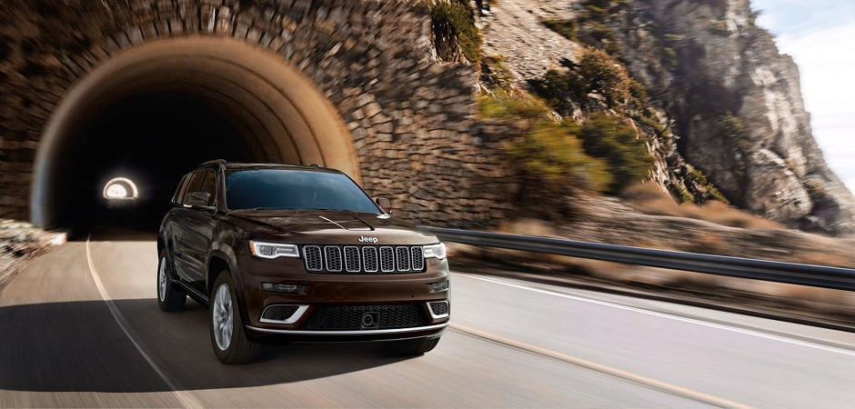 A 2017 Jeep Grand Cherokee driving fast through a tunnel