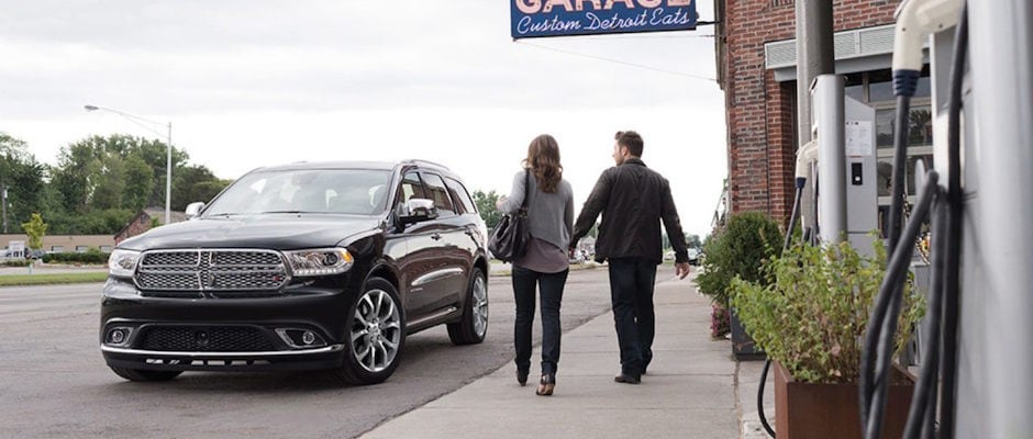 A couple walking to their 2018 Dodge Durango