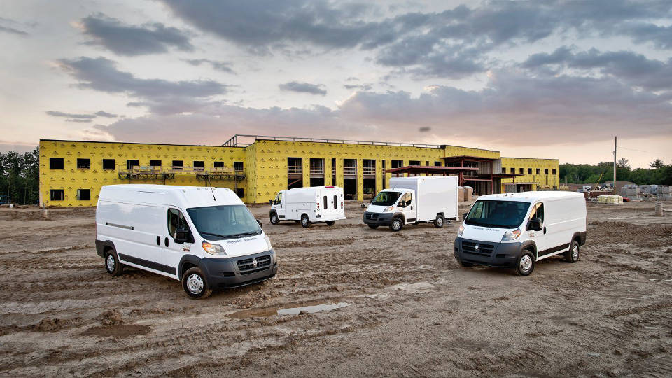 All of the available 2018 Ram commercial vehicles lined up at a worksite