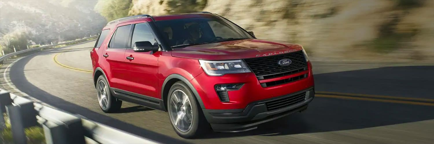 2019 Ford Explorer Sport in red turning a corner on a mountain