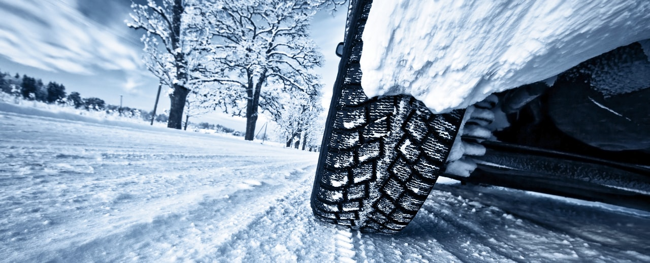 closeup of car tires on snowy road