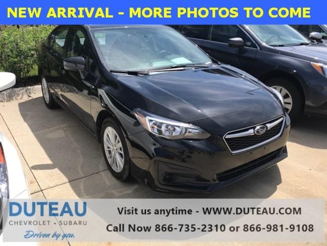 Pre-Owned 2017 Subaru Impreza 2.0i Premium Sedan for sale in Lincoln, NE
