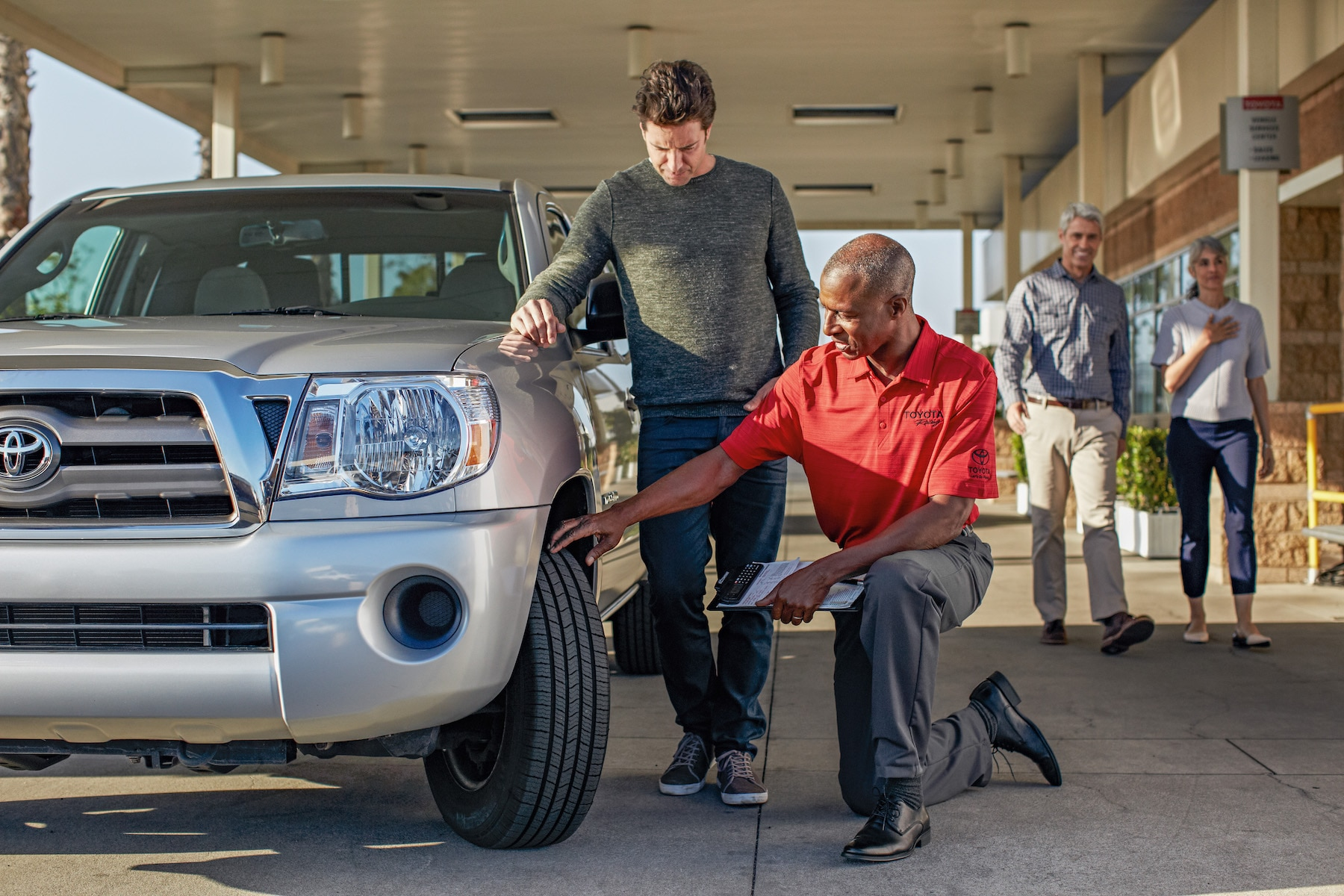 How to check your tires' health at Johnstons Toyota of New Hampton | Toyota Technician checking out car tire depth