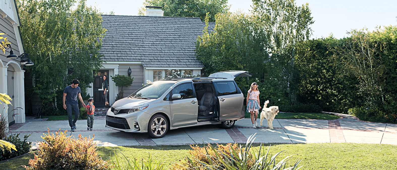 Family getting in their Toyota Sienna
