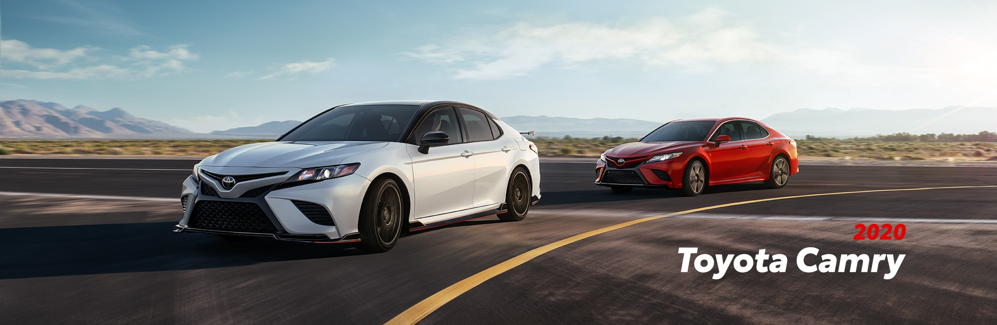 Model Features of the 2020 Toyota Camry at Johnstons Toyota of New Hampton | Two 2020 camry racing on the street
