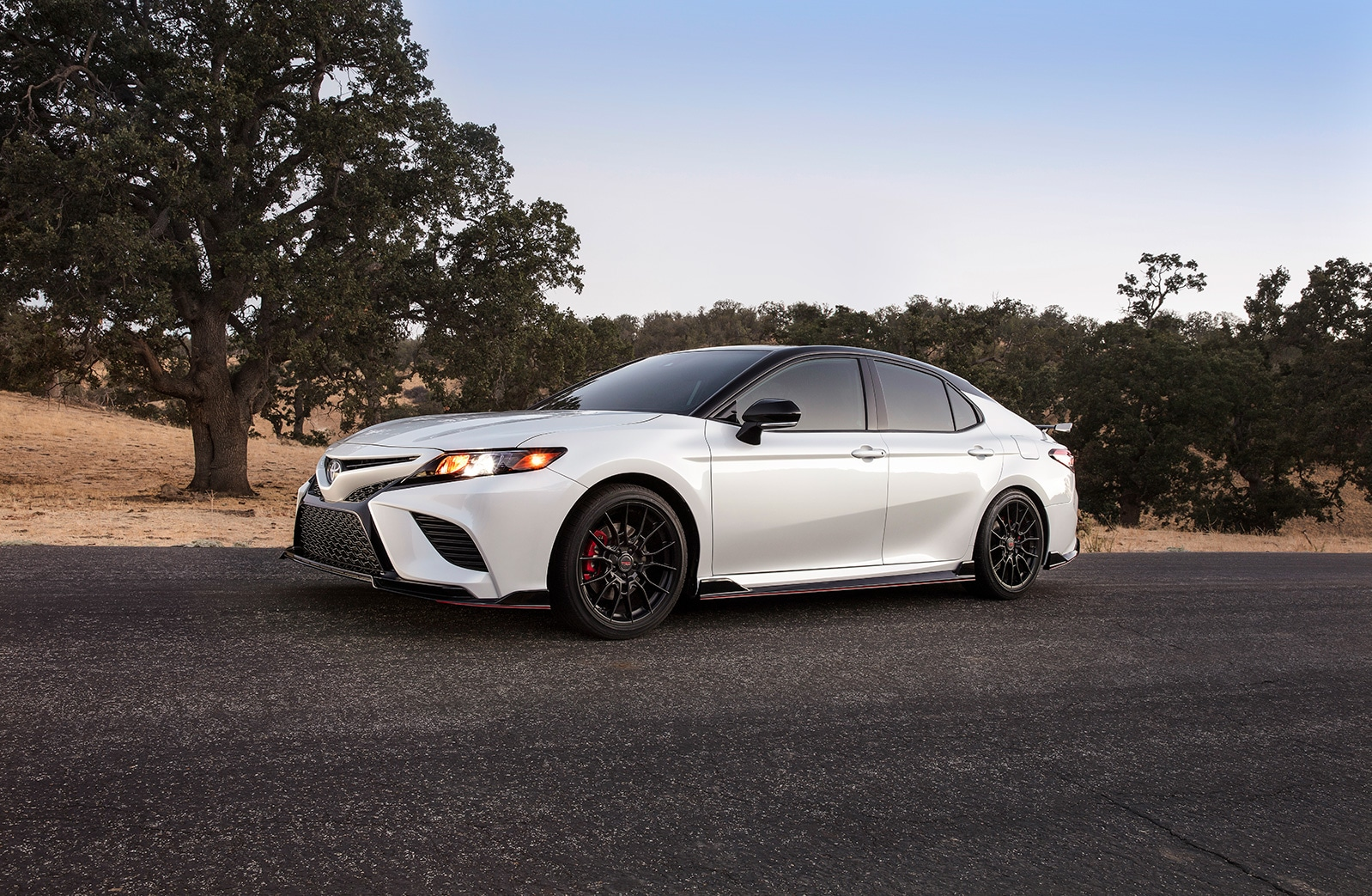 Model Features of the 2020 Toyota Camry at Johnstons Toyota of New Hampton | side profile of the 2020 camry