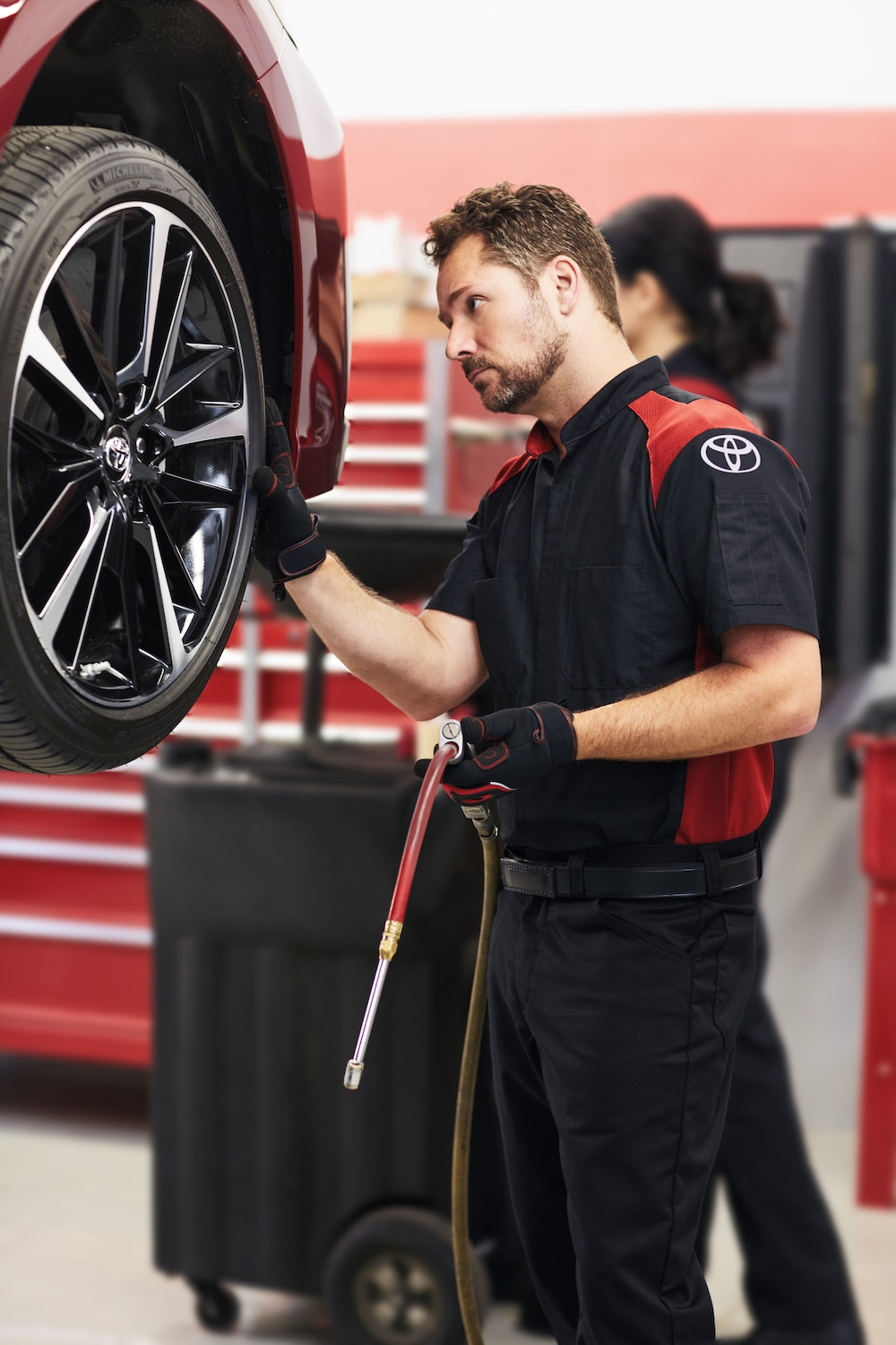 How to check your tires' health at Johnstons Toyota of New Hampton | Toyota Technician checking car tire