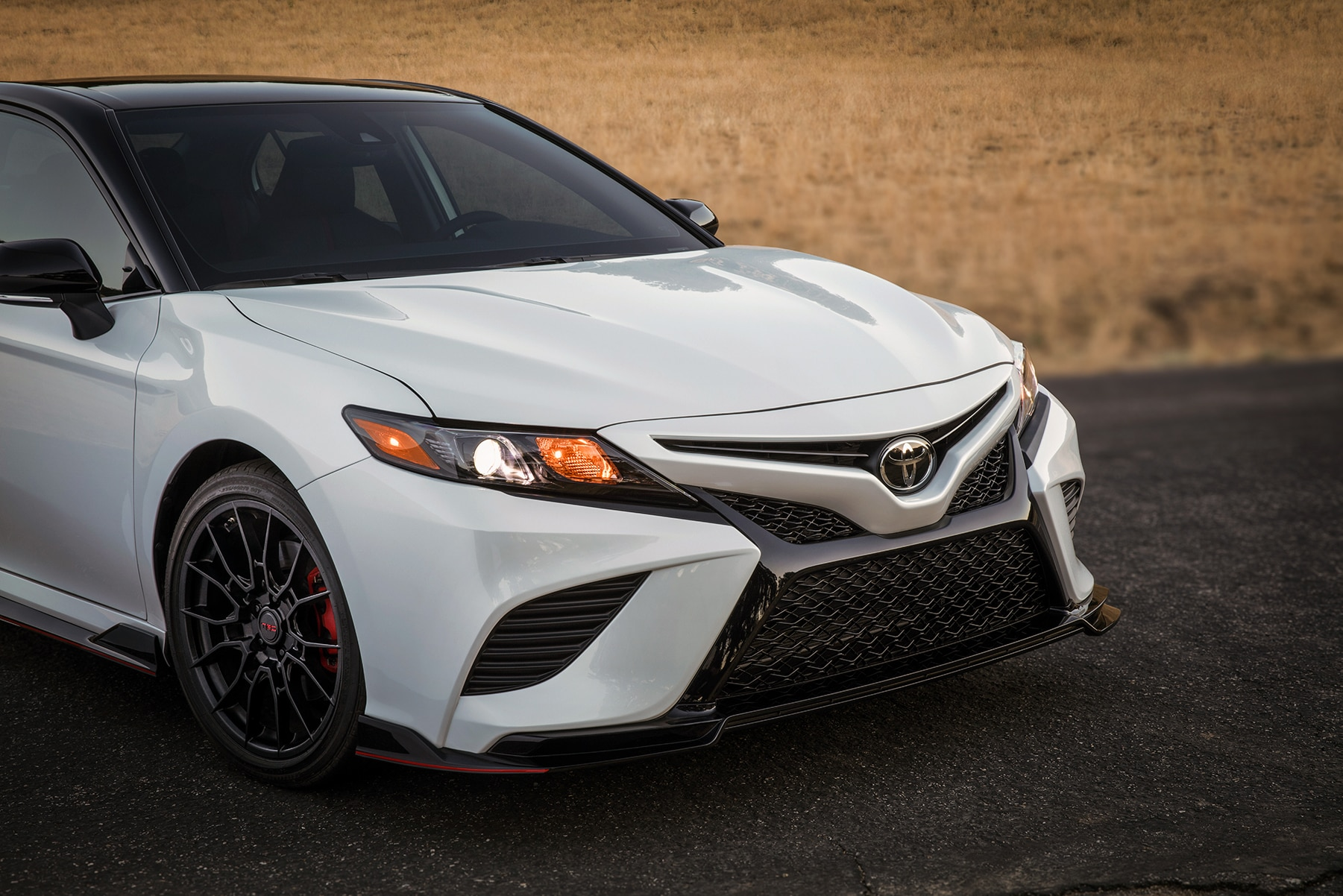 Model Features of the 2020 Toyota Camry at Johnstons Toyota of New Hampton | close up of the 2020 camry