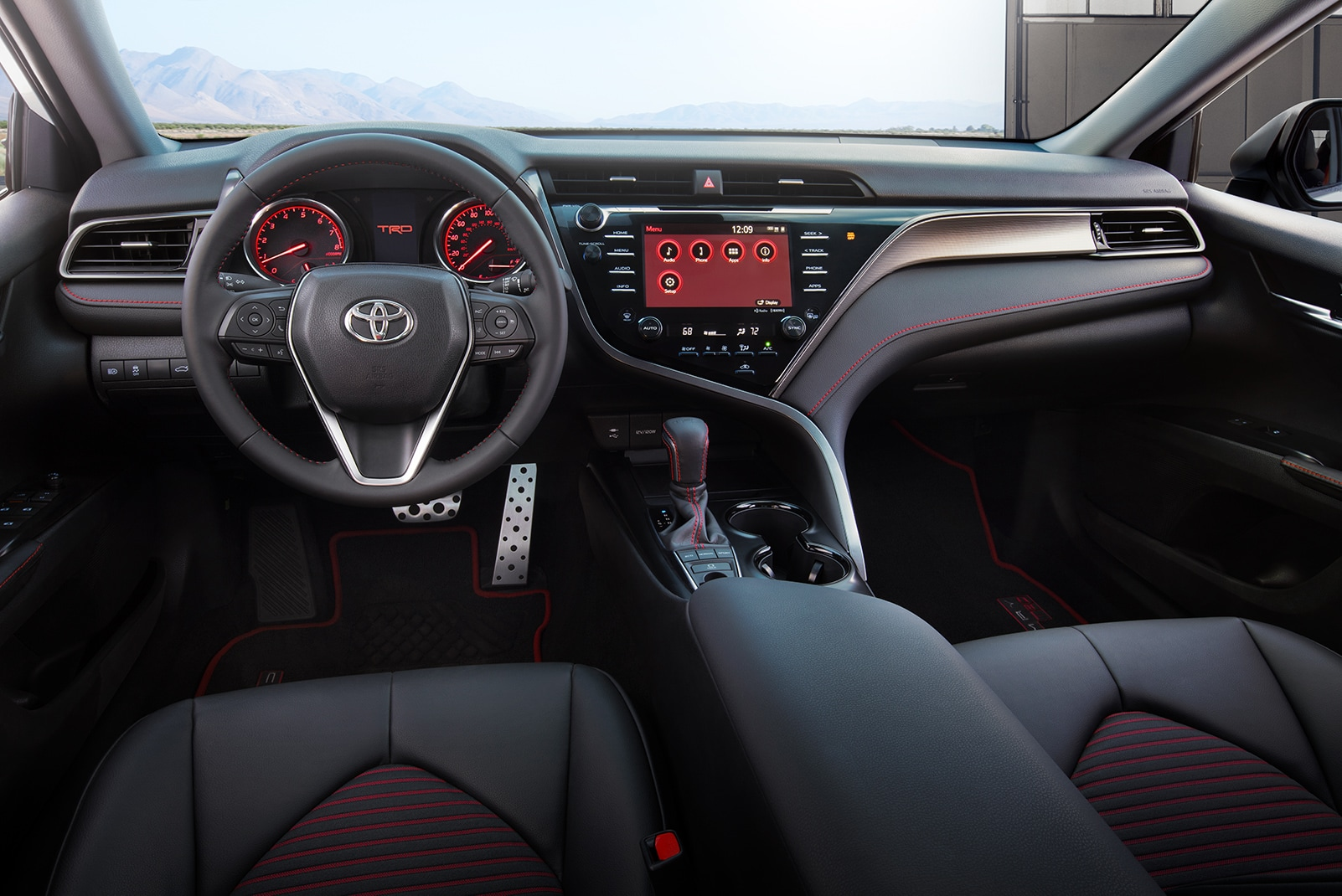 Model Features of the 2020 Toyota Camry at Johnstons Toyota of New Hampton | The dashboard of the 2020 camry