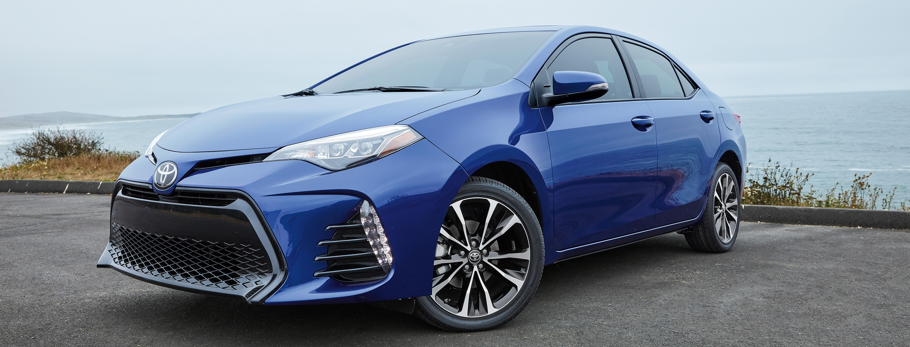 Profile of a blue 2018 Toyota Corolla