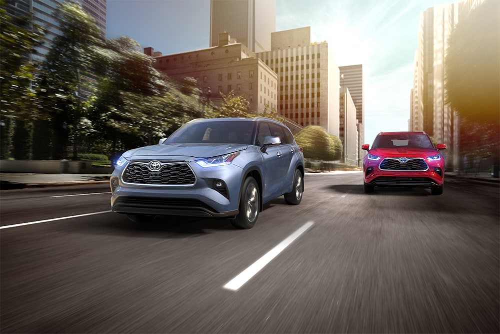 2020 Toyota Highlander coming soon to Johnstons Toyota of New Hampton | Blue and red 2020 toyota highlander running on road