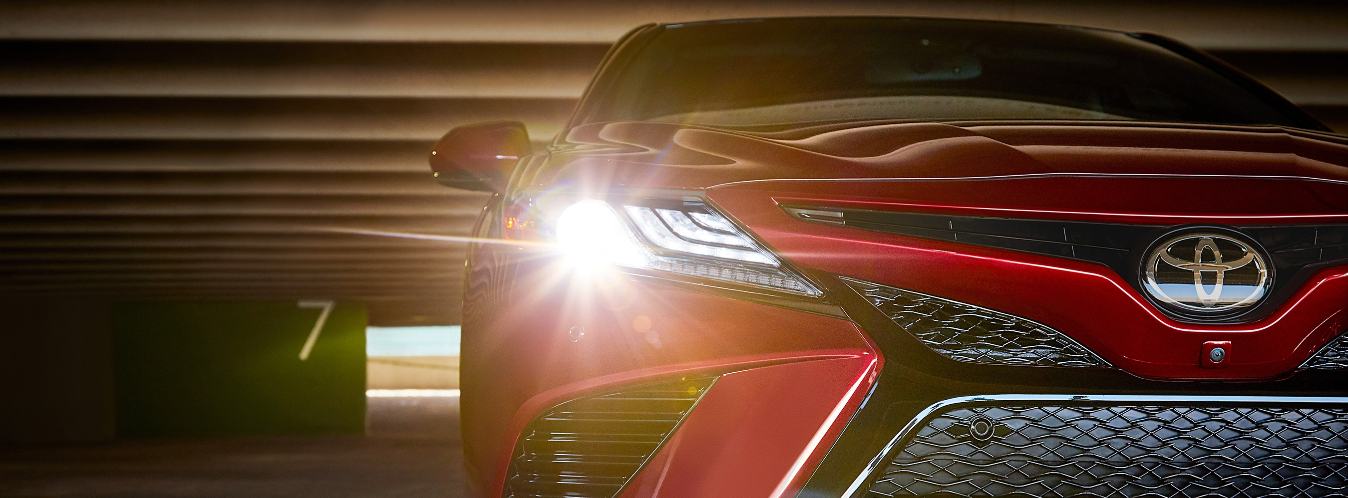 Up close shot of front grille and headlights of the 2018 Toyota Camry