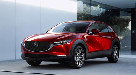 red new 2020 mazda cx30 in gray showroom in florida
