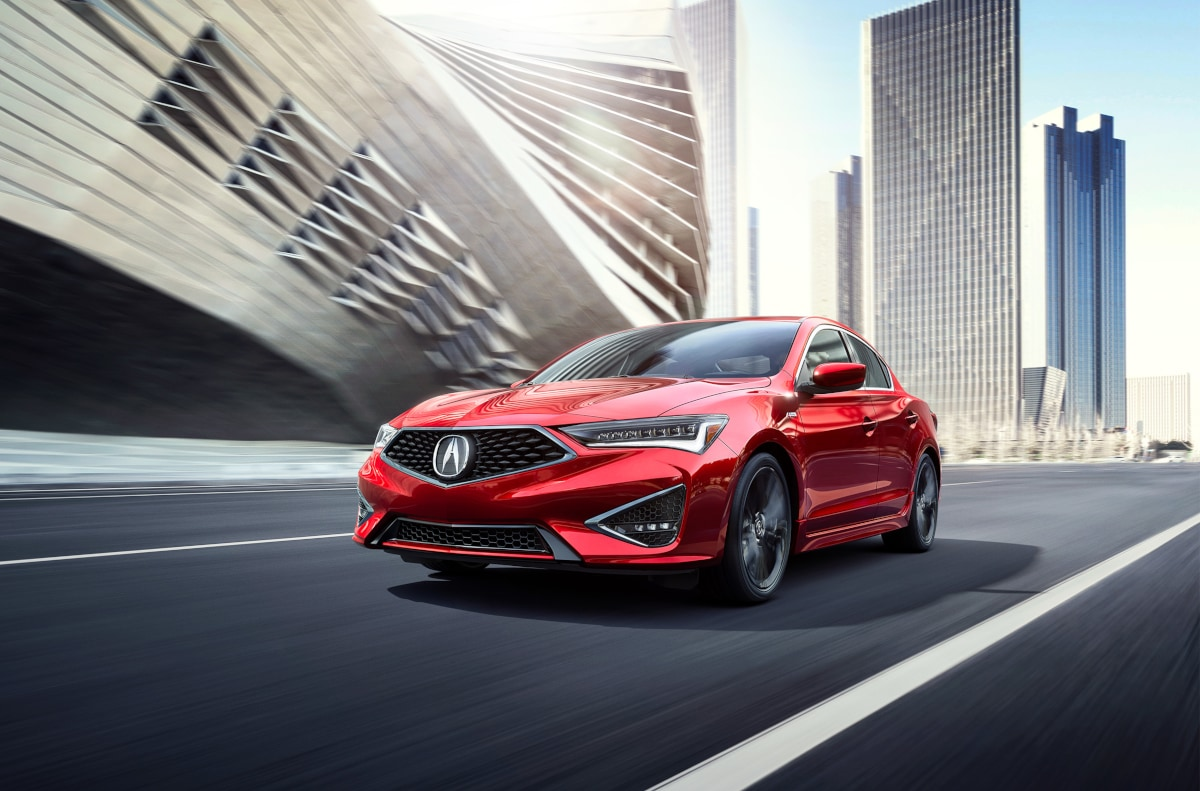 Acura ILX Compact Sports Sedan Speeding Down City Street