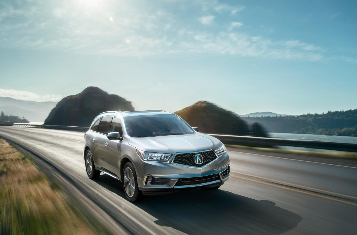 Acura MDX 3-Row SUV crossing bridge