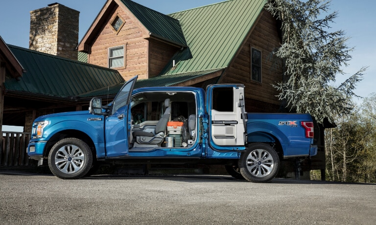 2020 Ford F-150 exterior side view with doors open to reveal interior cab