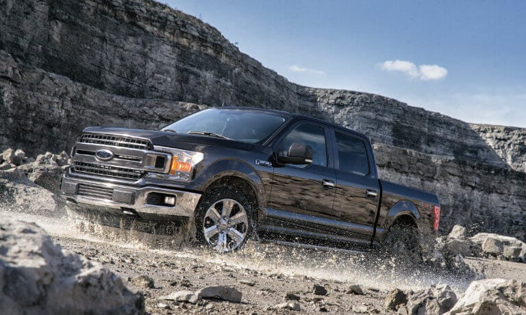 2020 Ford F-150 exterior driving on rocky canyon