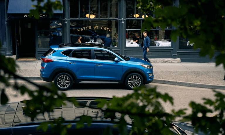 2021 Hyundai Tucson exterior in front of cafe