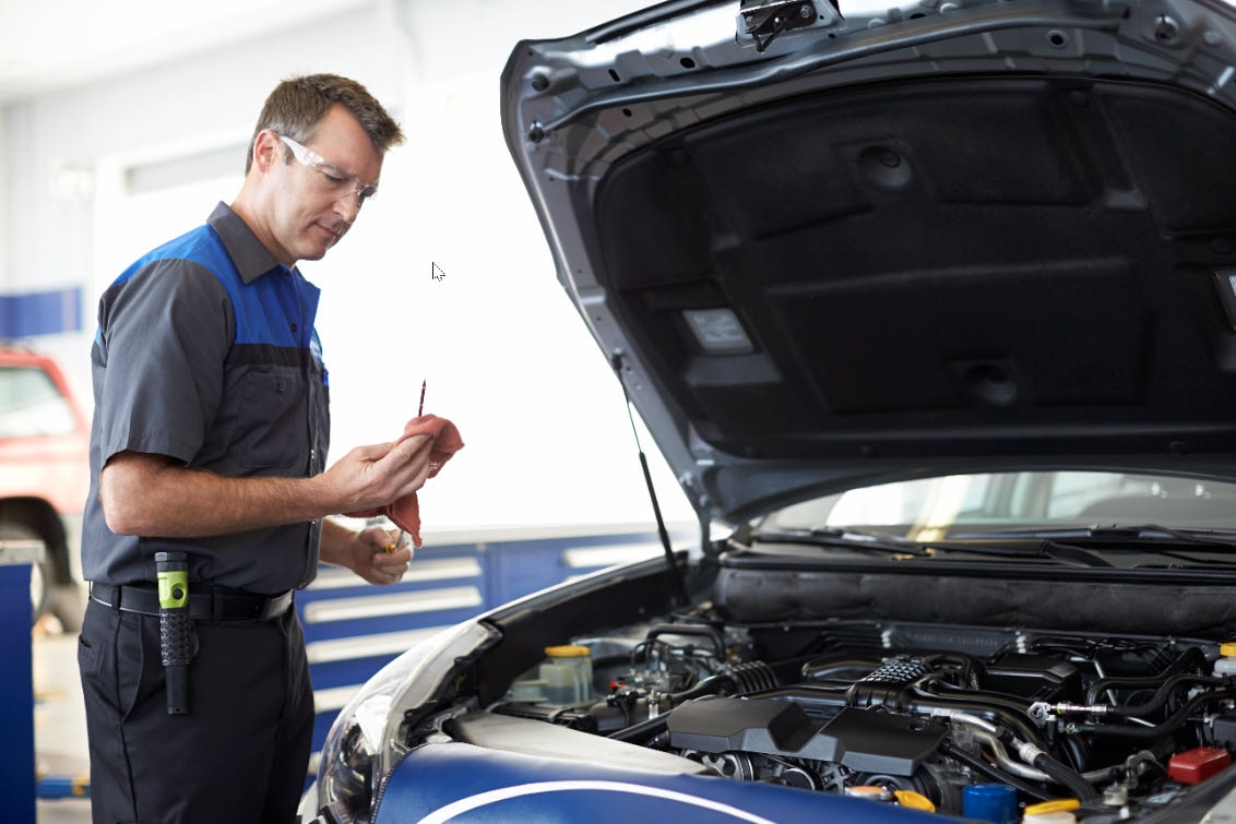 Subaru Service Technician Checking Dip stick after Oil Change