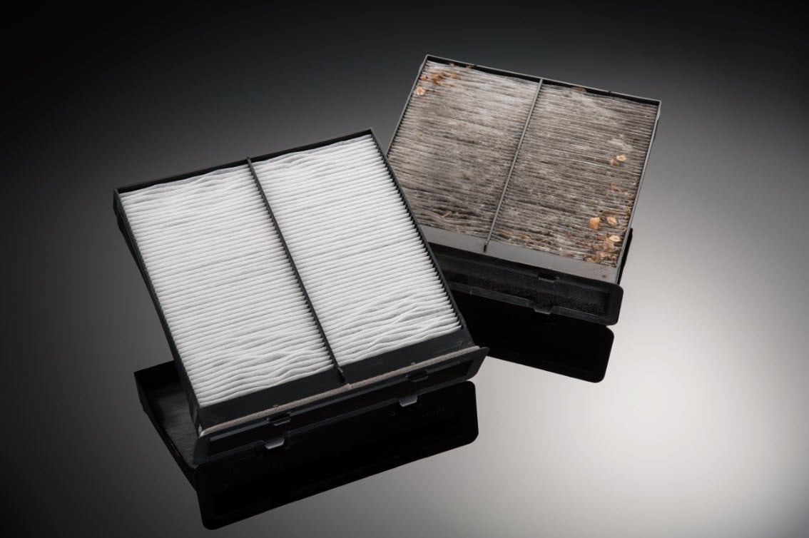 Image showing clean and well used cabin air filters side by side