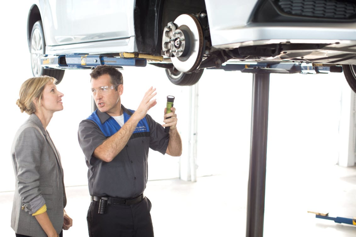 Image of Subaru Service Tech Performing Brake Inspection with Owner discussing Brake Maintenance