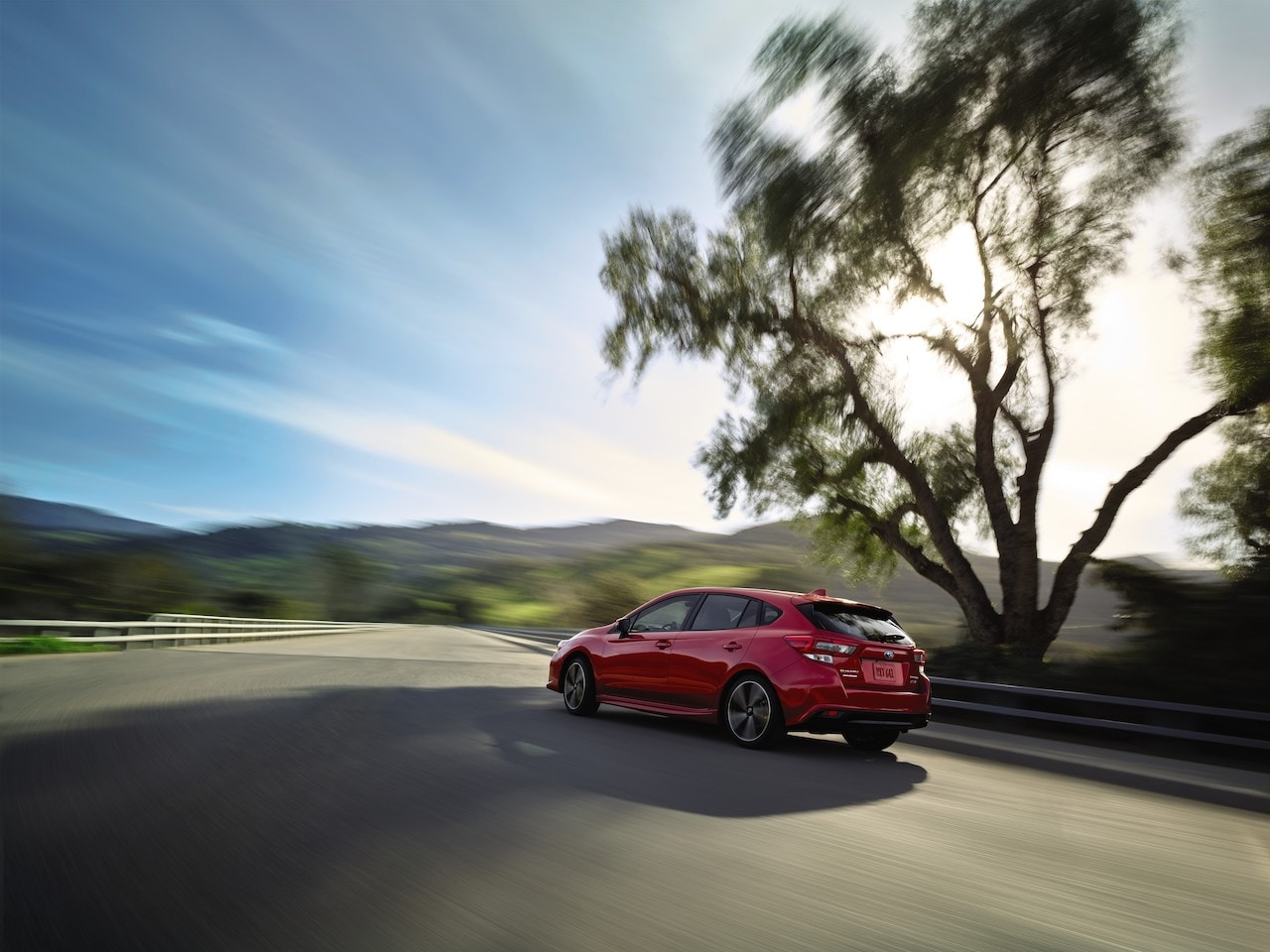 2020 Impreza 5-Door Red rear at speed