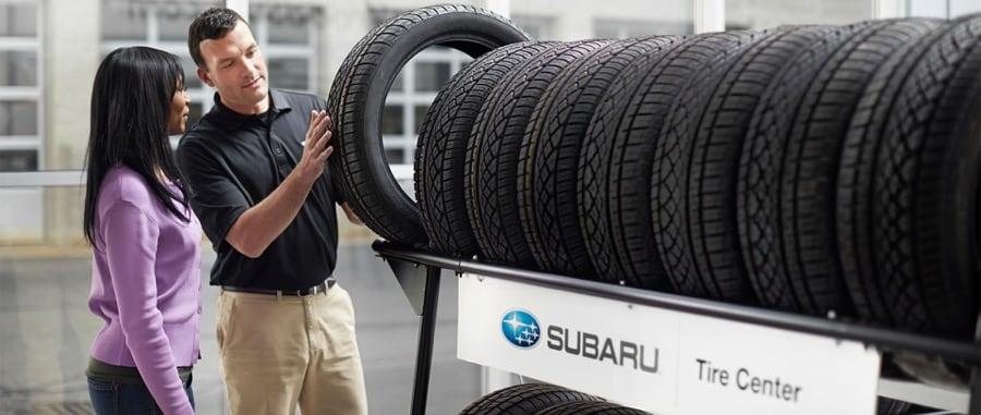 Subaru tire store sales person and customer