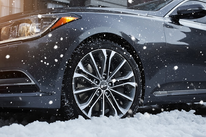 Hyundai Genesis front tire in snow