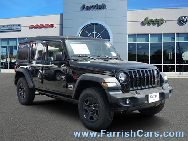 New 2018 Jeep Wrangler UNLIMITED SPORT 4X4 black clearcoat exterior tan interior Stock 32377 VI