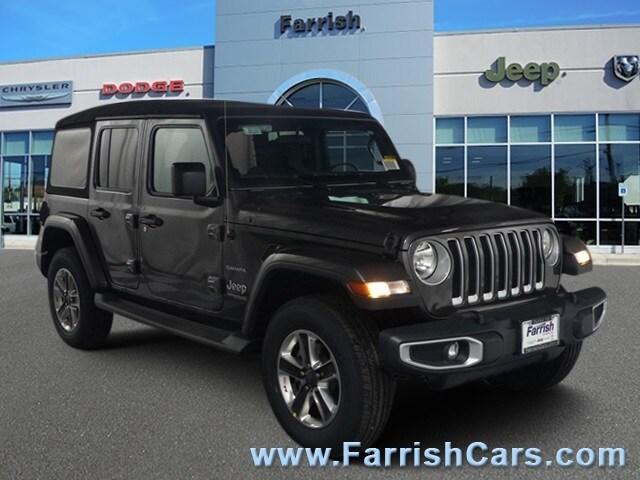 New 2018 Jeep Wrangler UNLIMITED SAHARA 4X4 crystal metallic exterior black interior Stock 33100