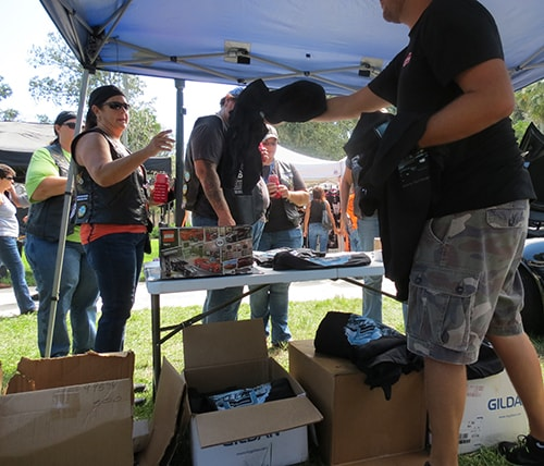 photo of Ferman Volvo handing out complimentary t-shirts at a local Cotee River Bikefest