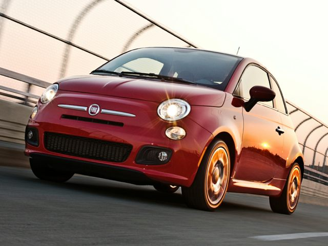 2012 FIAT 500 traveling along an urban bridge