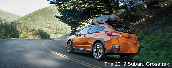 Sunshine Orange 2019 Subaru Crosstrek driving - Findlay Subaru Prescott, AZ
