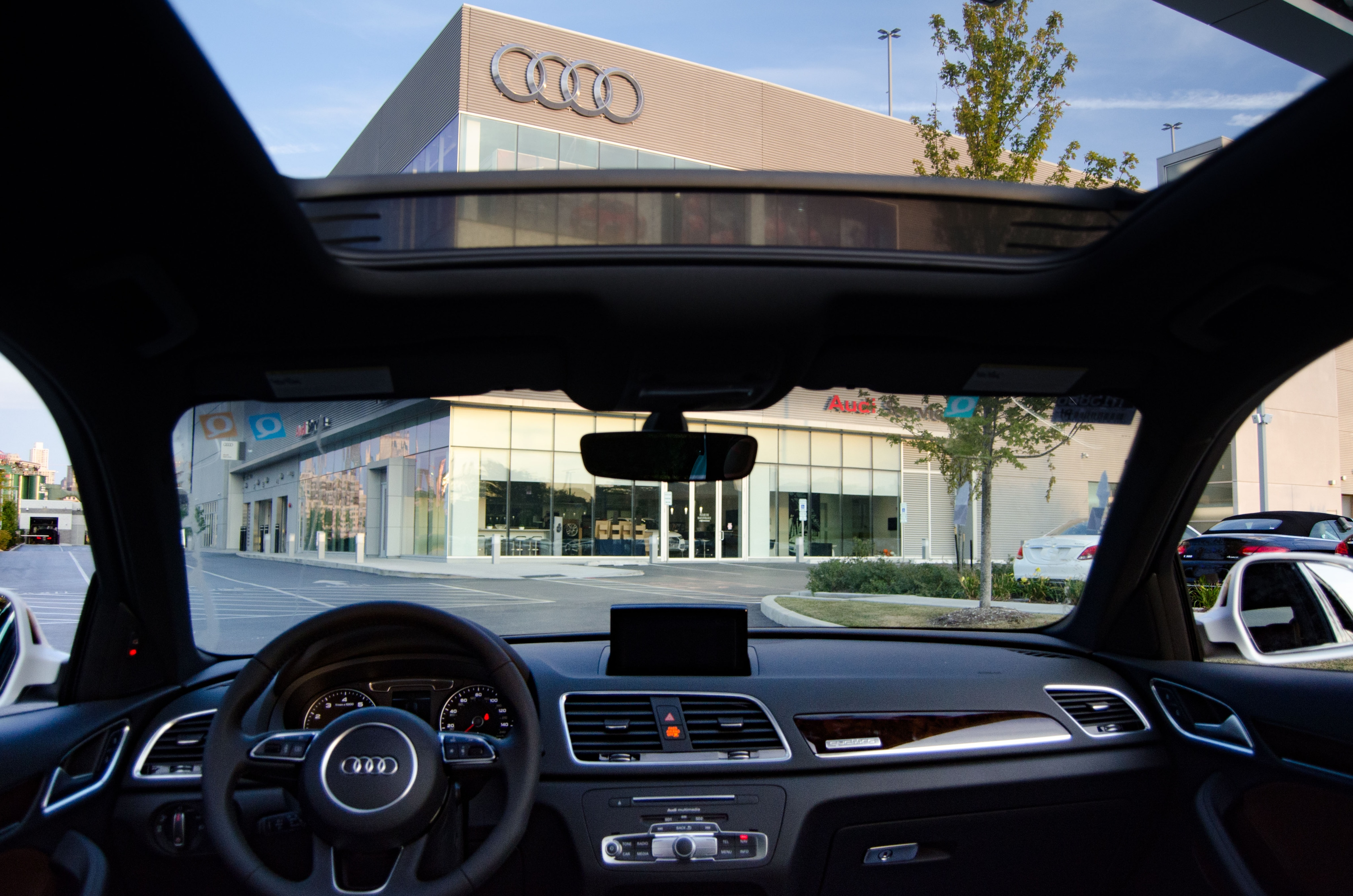 chicago and blog view showroom of stage a jones march the fletcher audi new htm all beautiful sales design against modern skyline dealership sets chic